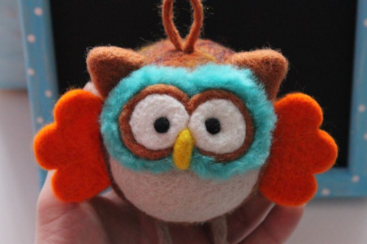 Brown owl with orange wings . Made on a Styrofoam form