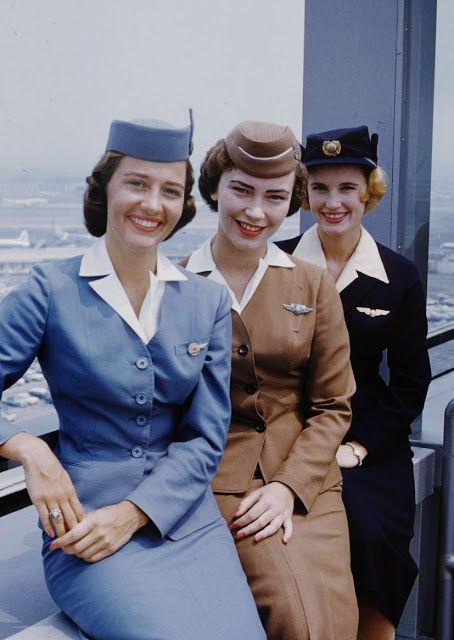 1950s flight attendant uniforms dress suit blue brown black hat shirt women's vintage fashion found photo print ad color