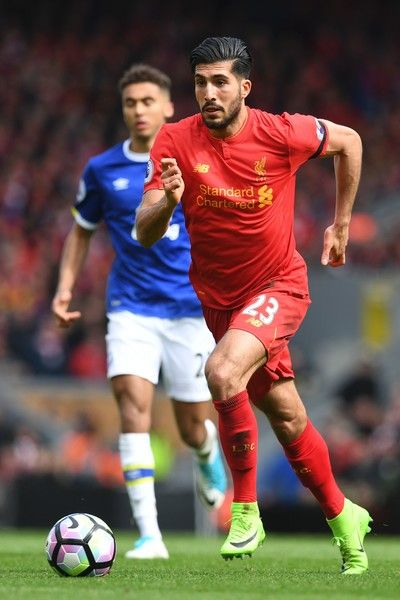 Liverpool's German midfielder Emre Can runs with the ball during the English Premier League football match between Liverpool and Everton at Anfield in Liverpool, north west England on April 1, 2017. / AFP PHOTO / Paul ELLIS / RESTRICTED TO EDITORIAL USE. No use with unauthorized audio, video, data, fixture lists, club/league logos or 'live' services. Online in-match use limited to 75 images, no video emulation. No use in betting, games or single club/league/player publications.  /