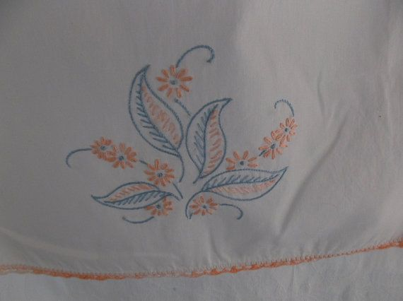 Beautiful blue embroidery adorn this white cotton mantle cloth with a peach crocheted edge.  Perfect for your cottage or shabby decor.  This