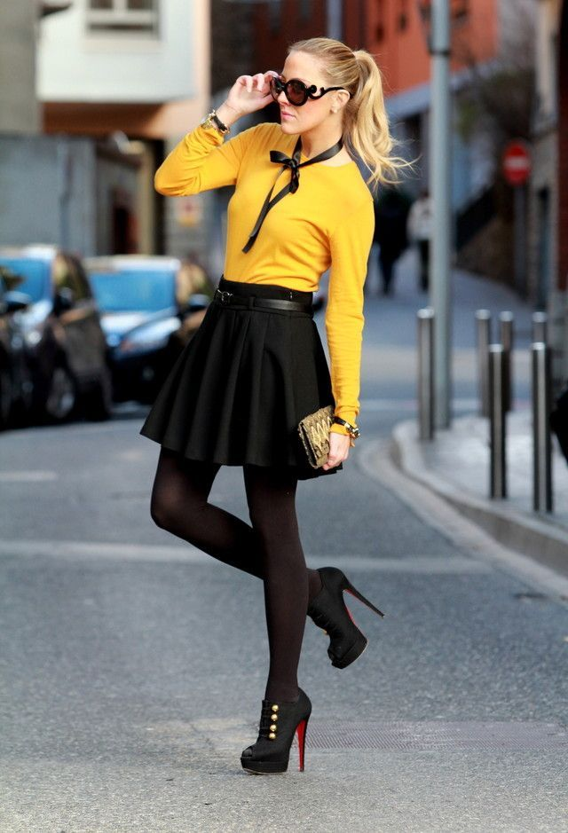 Shop this look on Lookastic:  http://lookastic.com/women/looks/sunglasses-crew-neck-sweater-belt-skater-skirt-clutch-tights-ankle-boots/8382  — Dark Brown Sunglasses  — Mustard Crew-neck Sweater  — Black Leather Belt  — Black Skater Skirt  — Olive Print Canvas Clutch  — Brown Wool Tights  — Black Cutout Suede Ankle Boots