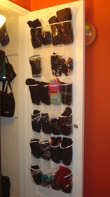 Winter Organization Tip: keep gloves, scarves, and hats in an over-the-door shoe holder.