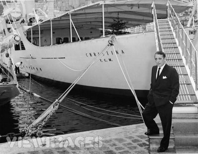 """Aristotle Onassis standing by his yacht the """"Christina O"""""""
