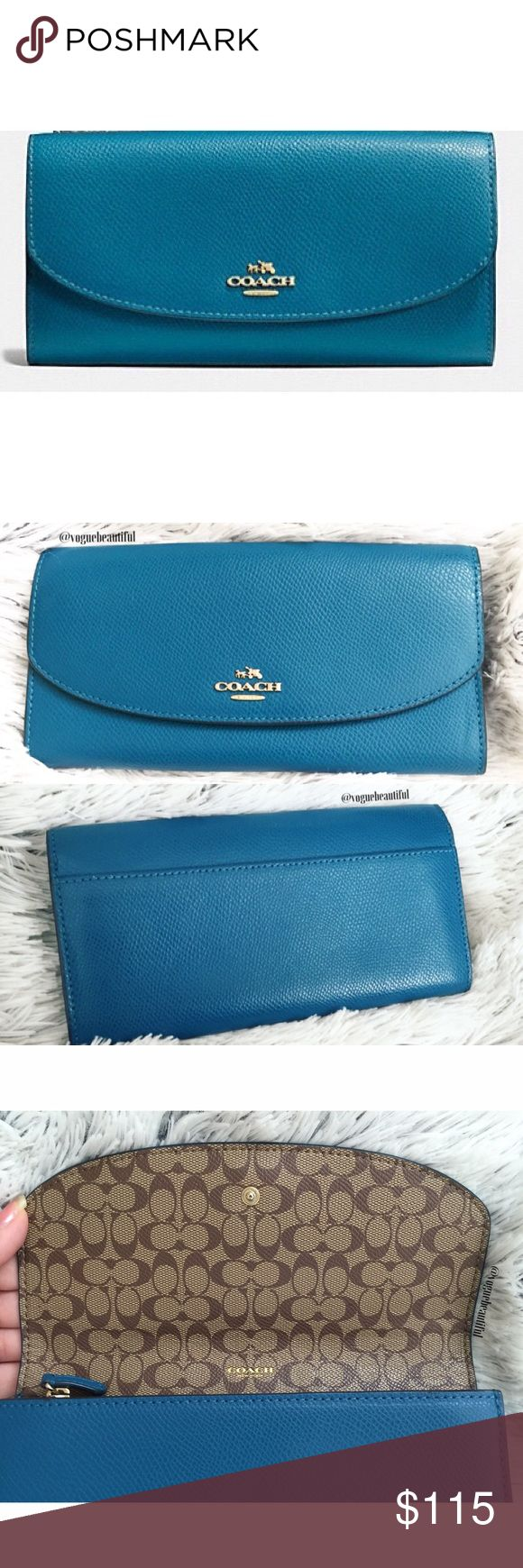Coach Teal Slim Envelope Wallet Gorgeous teal color 100% authentic Coach wallet • color is most like stock photo, my camera didn't do the beautiful teal color justice• in like new condition with no flaws • DIMENSIONS: 7.75 inches across x 4 inches in height (when closed) • snaps open • 12 card slots, zipper coin pouch, and cash pocket • ✨matching Coach Bag also available in my closet! ✨ • NO TRADES‼️ Coach Bags Wallets