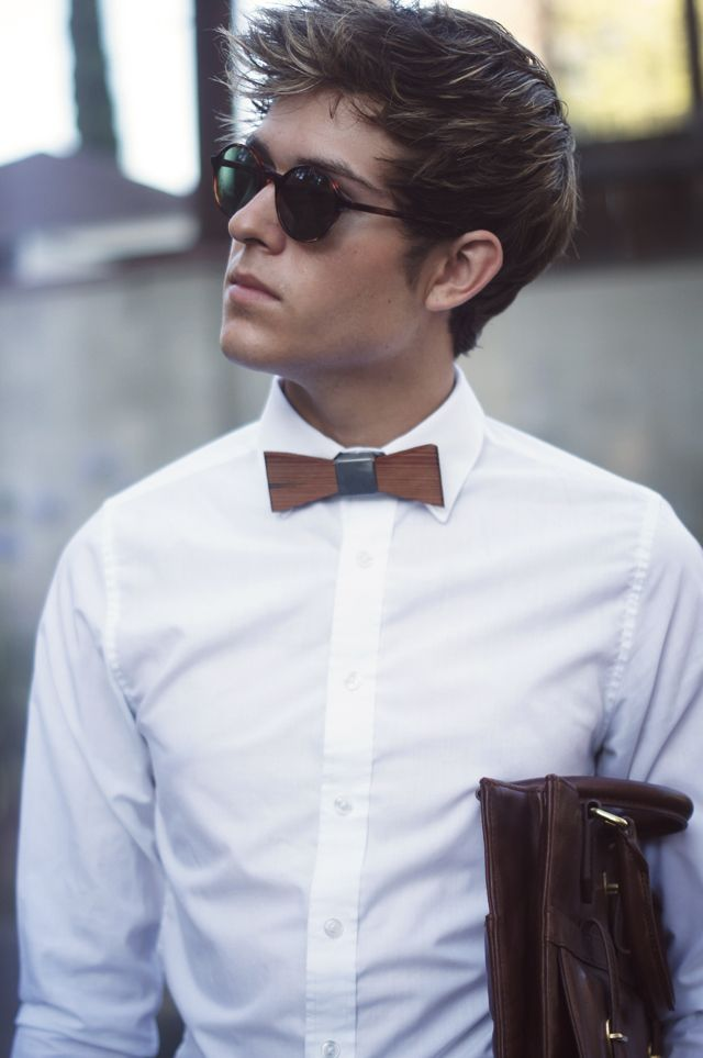 Bow ties tend to be associated with formal wear, but men's novelty bow ties add an unexpectedly fun element to the classic accessory. Because the novelty item resides on a small part of your outfit, you can get away with different materials and patterns for a subtle yet surprising addition.