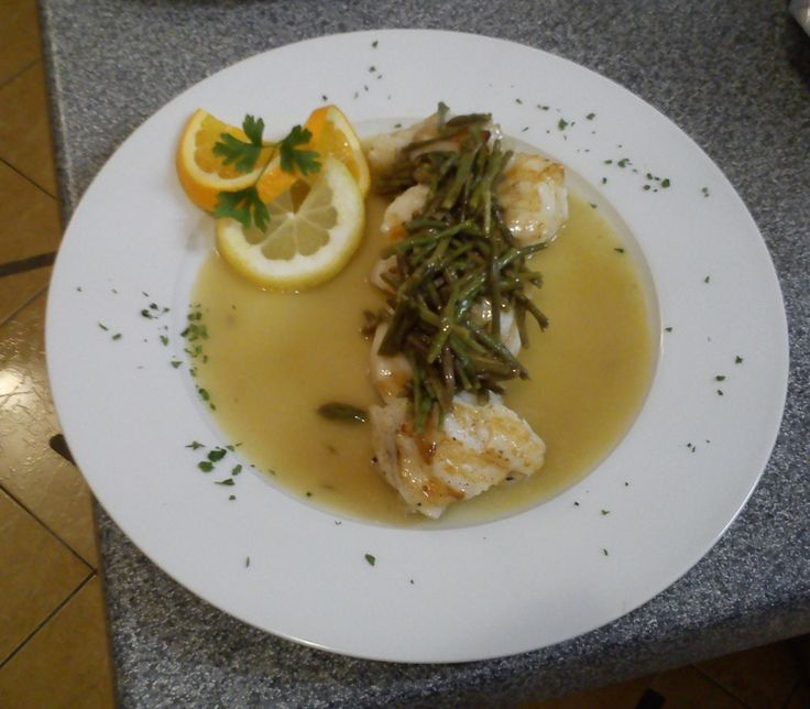 Monkfish in malvasia wine sauce with wild asparagus