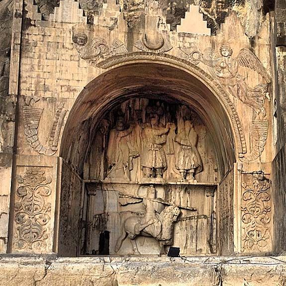 Sassanid Inscription, Taq-e Bostan, Kermanshah, Iran Anahita (left) blesses Khosrow II (center) while Ahura Mazda (right) grants the Ring of Power to him, so he can officially become the Shahanshah of Iran.