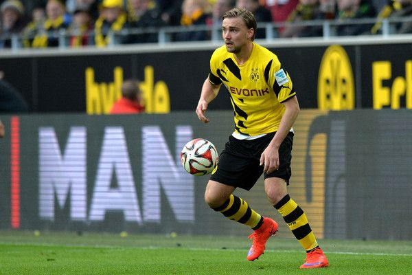 Marcel Schmelzer of Dortmund controls the ball during the Bundesliga match between Borussia Dortmund and FC Bayern Muenchen at Signal Iduna Park on April 4, 2015 in Dortmund, Germany. - 8 of 42