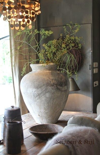 Large, earthy, clay urn with greenery. Love.