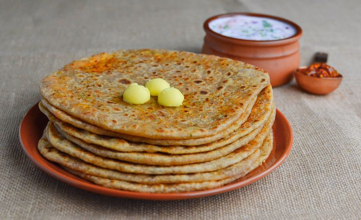 Whole wheat flatbread stuffed with grated Indian cottage cheese and spices – a delight for paratha lovers. This simple paneer paratha is ready in minutes and tastes absolutely wonderful. This paratha does not need any elaborate accompaniment – it tastes great with just some raita and pickle and optionally few pats of butter. These mildly spiced, …