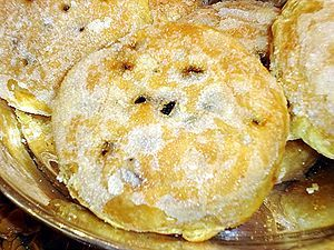 Eccles cake - aKa Squashed Fly Cake, Fly Cake, Fly Pie, Fly's Graveyard - An Eccles cake is a small, round cake filled with currants and made from flaky pastry with butter, which is sometimes topped with demerara sugar.