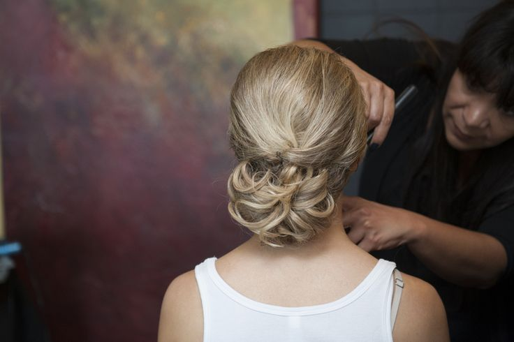 The bride wore her blonde hair in a gorgeous low chignon. |   Photo by Kathleen Hertel Photography