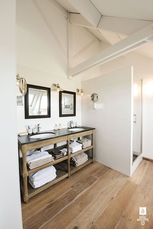 Attic Bathroom Features Sloped Ceiling Framing Skylight