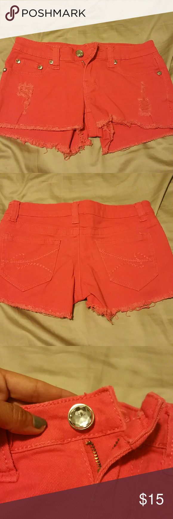 Coral Jean shorts Coral in color with rhinestone embellishments and some ripped up distress on front. Rue 21 Shorts Jean Shorts
