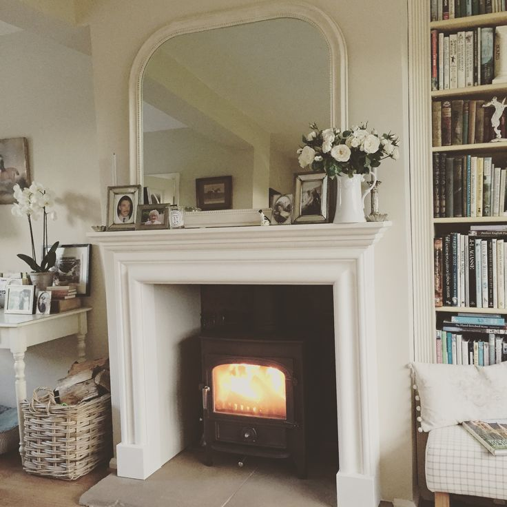Limestone bolection surround, Clearview Vision 500 stove in Goldenfire brown.