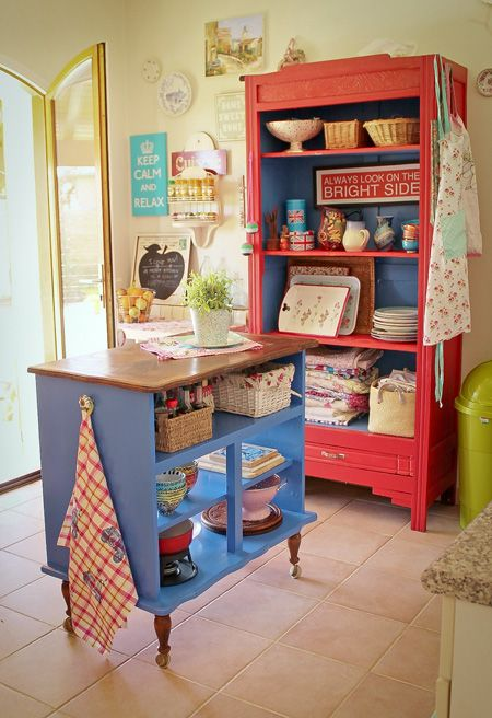 Kitchen island | Could easily create an island with a bookcase on legs? Making it the exact needed height...