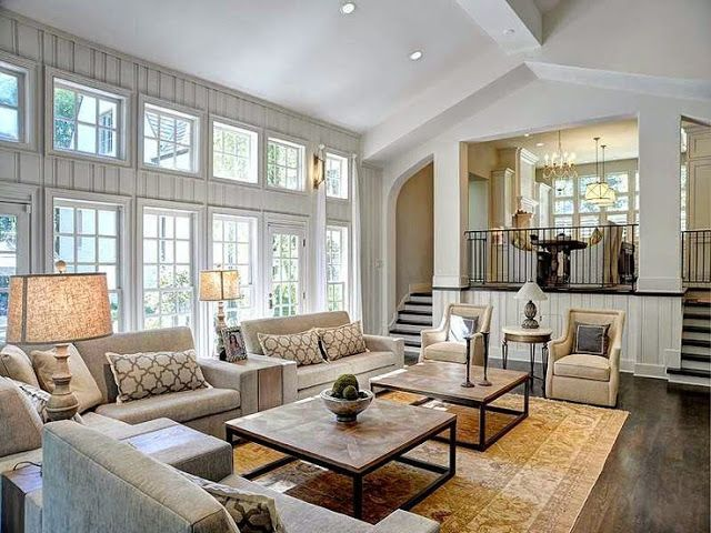Large open floor plan white living room traditional decor neutral colors two story windows - Decorating a large living room ...