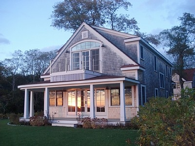 Cape Cod house, love the second floor balcony