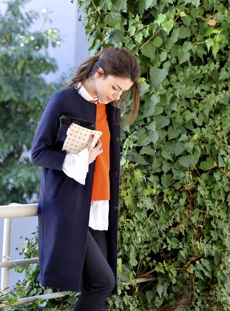Like white collar shirt under orange cardigan