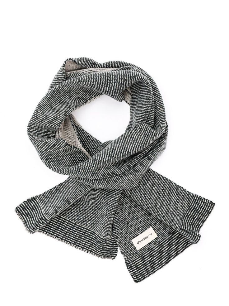 Oliver Spencer Bamako Scarf: Tap into Oliver Spencer's distinctive city style with the Bamako scarf. Crafted from 100% extra fine wool, this useful scarf and warm way of adding some texture to an outfit. Pair with the Bamako hat.
