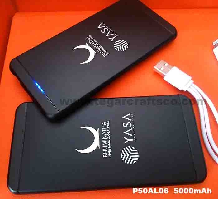 Powerbank P50AL06 5600mAh: Material: aluminum, Capacity: 5.000mAh 3.7V- Real Capacity, Input: 5V 2A (fast charging), LED Indicator, 4 Connector (Micro USB, Mini USB, Nokia, Iphone 4), 1 year warranty. elegant black design is inspired by Apple, ideal for merchandising pharmaceutical company and its products, as shown above, powerbank ordered by PT Yasa Construction feat. PT Bhuminata Ivestama Globalindo, Jakarta Indonesia