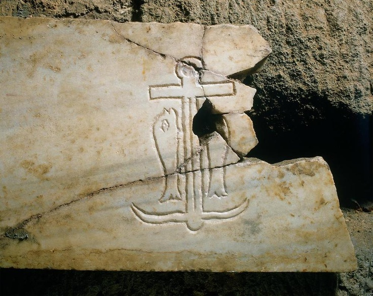 So this image in the catacombs of St. Sebastian is one of the oldest examples of the cross, which is cleverly hidden in the anchor. While the anchor originated as a general symbol of hope, it became a symbol for hope in Christ of the cross.