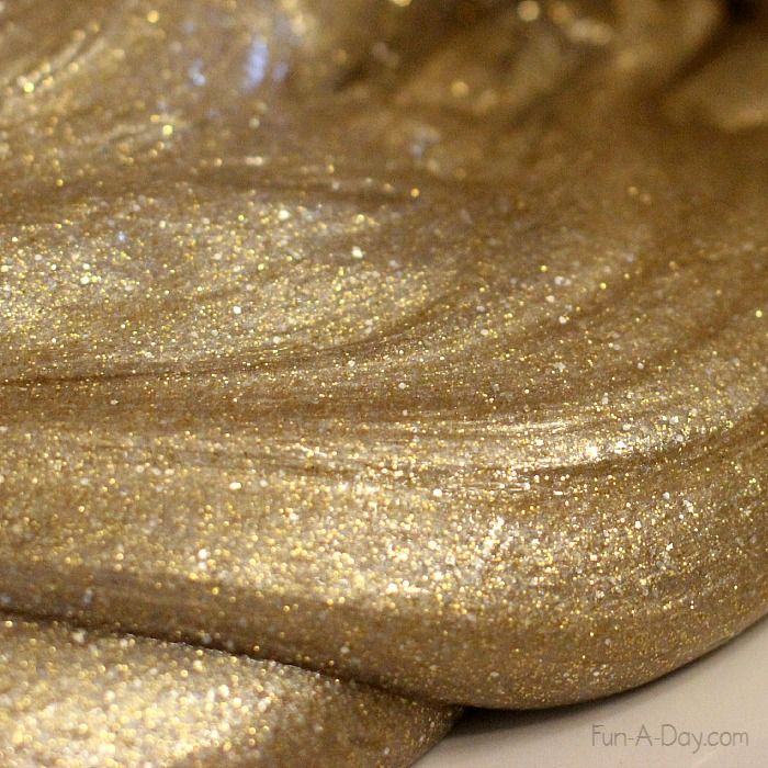 A beautiful mix of gold and silver homemade slime for kids to explore
