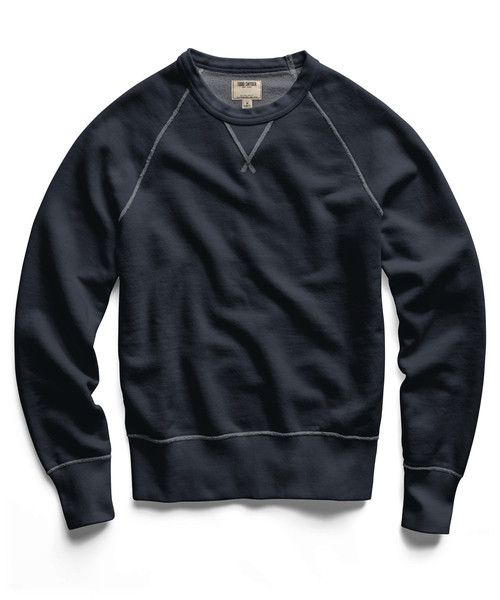 We don't believe that sweatshirts have to be subjugated to days spent watching football on the couch. Constructed from black indigo French terry that fades with time like your favorite pair of jeans,