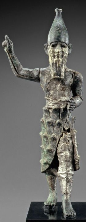 Detailed cast bronze, hammered over with silver sheets on the body, electrum on the face. Strongly resembles the Canaanite Baal, a region of people in the area of the present-day Israel, Lebanon and Palestinian territories.