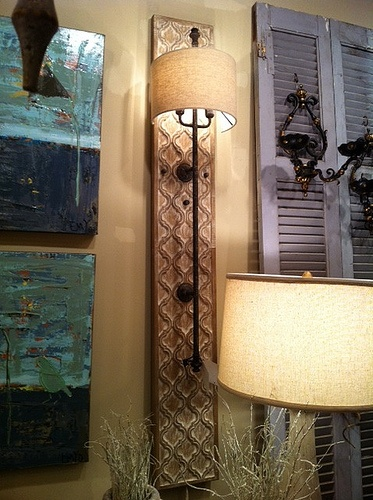 wall sconce..not like this but could solve the visible cord issue