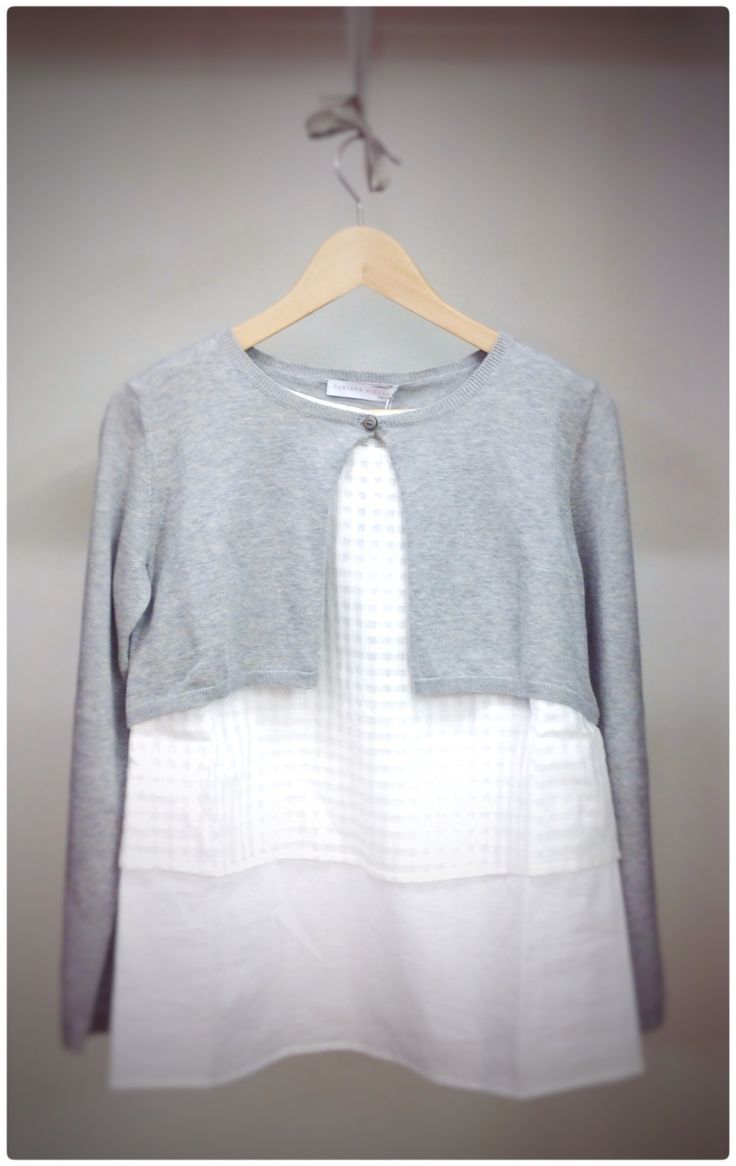 The refined #style characteristic of #FabianaFilippi in this creation , where the short and grey  #sweater in pure #cotton has been joined  with the double white #tanktop that you see below . Buy Fabiana Filippi in our #Online  #store www.lanamoda.