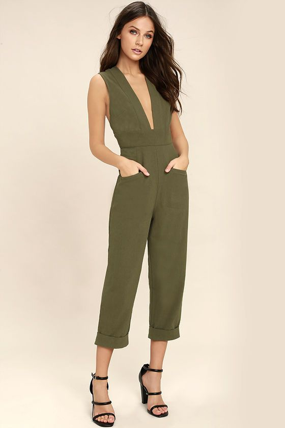 The Somedays Lovin' Little Lake Olive Green Jumpsuit is sexy and laid-back all at once! Woven cotton jumpsuit with a plunging V-neckline, darted bodice, and an tying, open back with adjustable straps. Set-in waist tops relaxed pant legs with welt front pockets, back patch pockets, and cuffed hems. Hidden back zipper/clasp.
