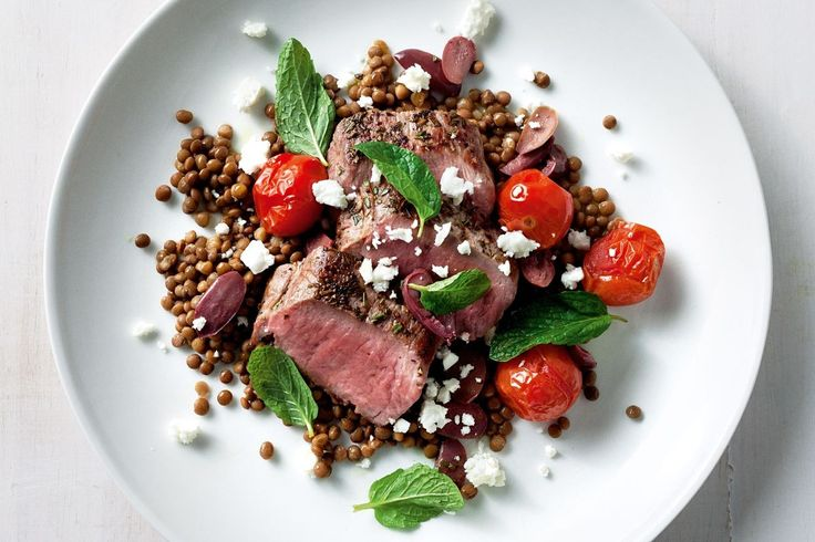 Lentils are a useful (and filling) way to help balance the proportions of meat to non-meat on your plate. Jill Dupleix's lamb recipe uses the robust flavours of sweet roasted cherry tomatoes and salty feta and olives to make every mouthful exciting.