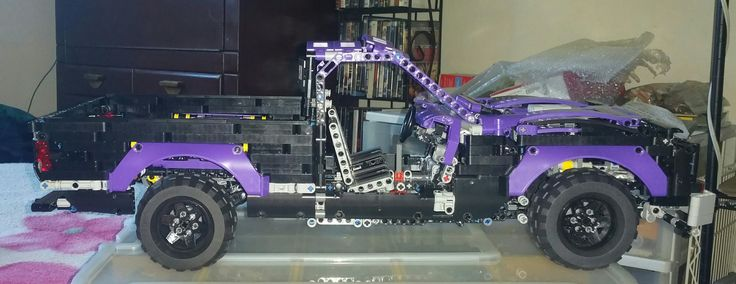 MY LATEST MOC BUILD WHICH IS OF A Z71 CHEVY SINGLE CAB SHORT BED 2WD PICKUP,STILL HAVE TO FINISH BUILDING CAB ALONG WITH DOORS.CHASIS OF THIS MODEL CAME FROM CROWKILLERS 2014 AMERICAN MUSCLE CAR.LENGHT IS ABOUT THE SAME AS 42056 LEGO TECHNIC PORSCHE 911 GT3 RS MODEL IN SIZE.