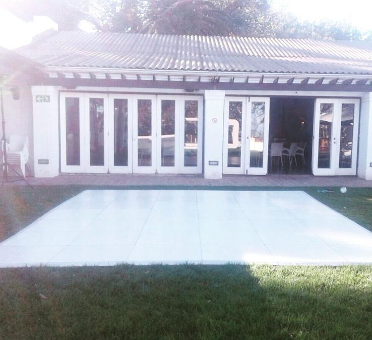 A Pearl Teak floor on the lawn at a private residence #connectafloorcape #eventflooringcapetown