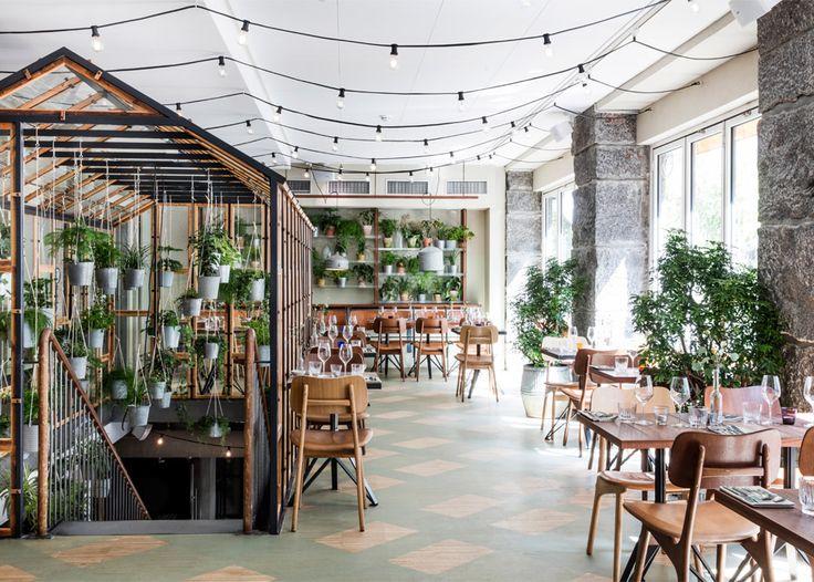 The centrepiece of this garden-inspired Nordic restaurant in Copenhagen is an indoor greenhouse that Danish design studio Genbyg has created using recycled materials