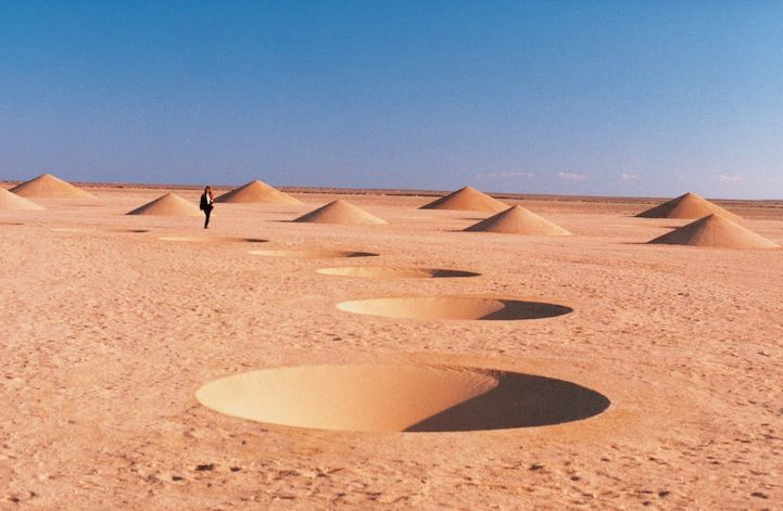 In the Sahara near the Red Sea: Desert Breath. This site-specific installation was the work of D.A.ST. Arteam, made up of Danae Stratou (installation artist), Alexandra Stratou (industrial designer and architect), and Stella Constantindies (architect). Created from 1995 to 1997 using 8,000 square meters of sand. The curves of the two interlocking spirals are dotted with cones that create both positive and negative shapes, as some point up towards the sky while others extend below the…