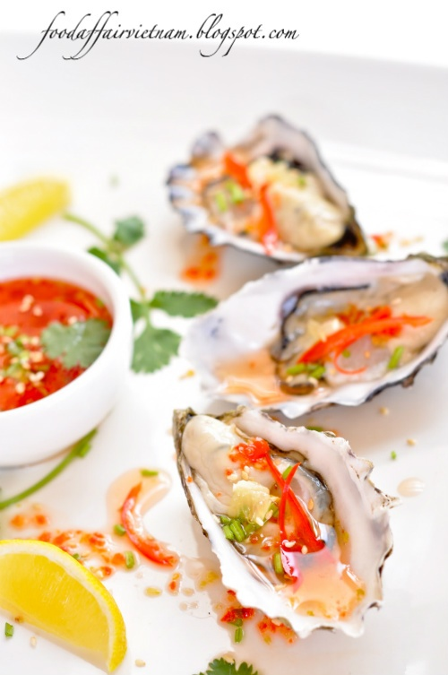 Oysters with Sweet Chili Vinaigrette.. I am sooooo hungry right now..Daniel and I had some really good ones in Carmel.
