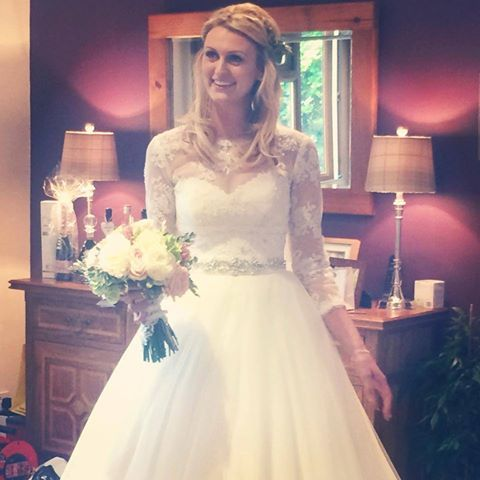Jenna looking radiant in her Mori Lee gown, personalised with a stunning lace jacket.  #weddingdress #weddings #weddinginspiration #morilee #bridalgown #stunning