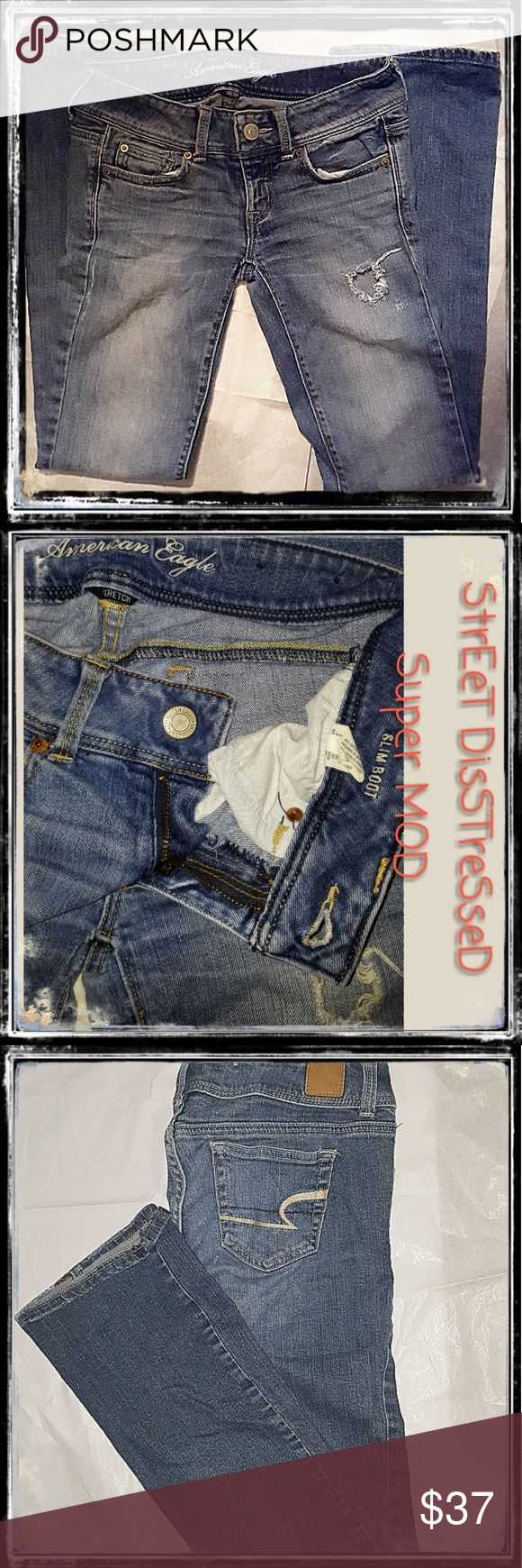 American eagle  street distressed super mod jeans American  eagle  slim boot  stretch  these were factory distressed   in a more aggressive  street distress in a slightly darker denim ...and through loving use they  have perfect not worn out no frayed cuffs but a super mod hipster comfy jean .. Size 2 American eagle  Jeans Boot Cut