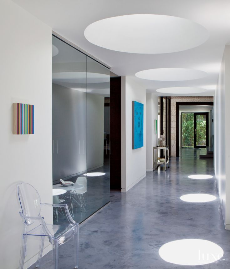 Modern White Central Hallway with Circular Skylights