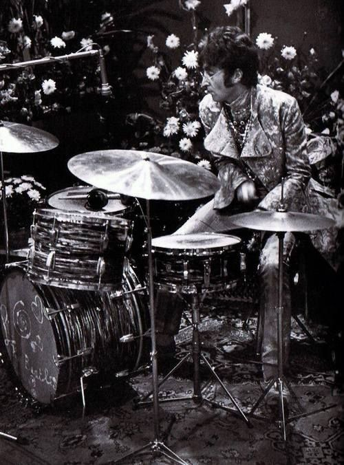 The Beatles, featuring John on drums.