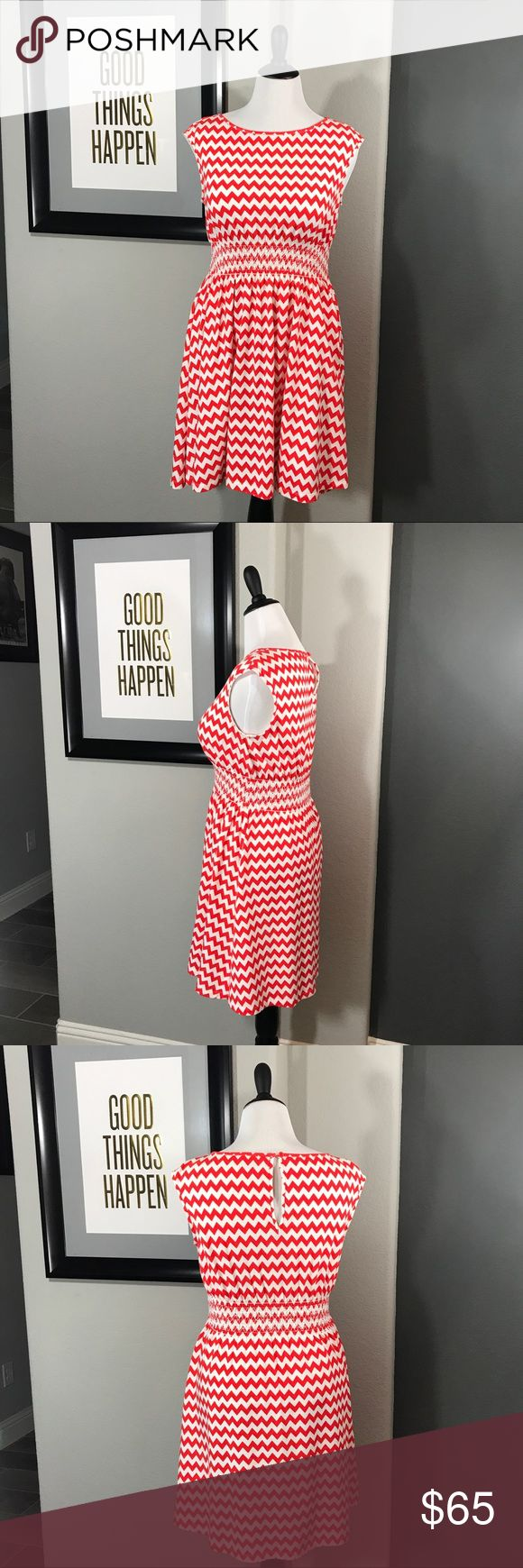 🔥SALE🔥⭐️KATE SPADE⭐️ orange chevron dress Medium ⭐️KATE SPADE⭐️ orange chevron dress Medium.  Super cute fit and flare dress. Smocked waistline defines the figure while being really comfy!  Pictures read a bit red...but it is definitely orange ☺️. Worn twice. Still bright. No piling. There are two tiny holes on the skirt near the left hip (see last pic). Difficult to see without looking for them. kate spade Dresses