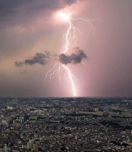 A bolt of lightening flashes over Saitama prefecture. Thunderstorms occurred in Tokyo as well as surrounding areas on Monday, killing a man who was taking shelter from rain under a tree.