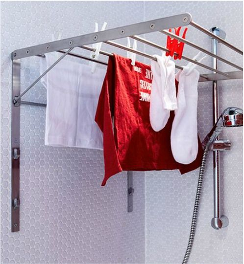 $20 No laundry room? No problem! I love the idea of installing a GRUNDTAL drying rack in the shower. (The unit folds flat when not in use.)