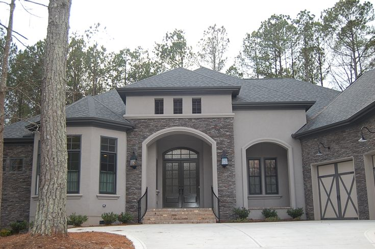 ARH plan the Bermeda 1129F (Exterior 16) Stone: Coronado Country Rubble - Grey Quartzite, Stucco: MW504 Oyster Gray, Roof: Owens Corning Driftwood, Fascia/Soffits/Trim: SW7047 Porpoise, Gutters: Terra Tone, Entry Porch Flooring: Hanson Grand Mocha (Gray mortar)