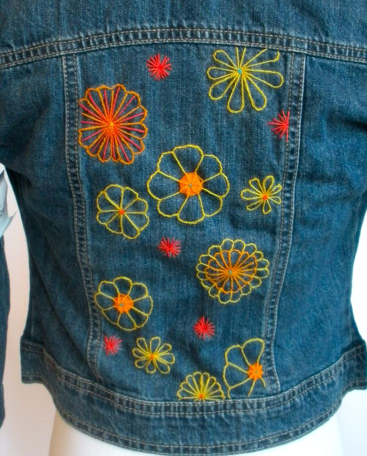 Crewel embroidery on girls' jean jackets, using flower and star motifs