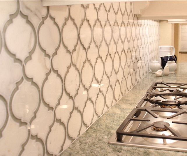 Kitchen Backsplash. The backplashl is a mix of calcutta gold marble and grey glass. This product is called Toledo Lucido Vetromarmi Glass and Stone Waterjet Mosaic. It comes on a 10x11.5 sheet. #KitchenBacksplahs