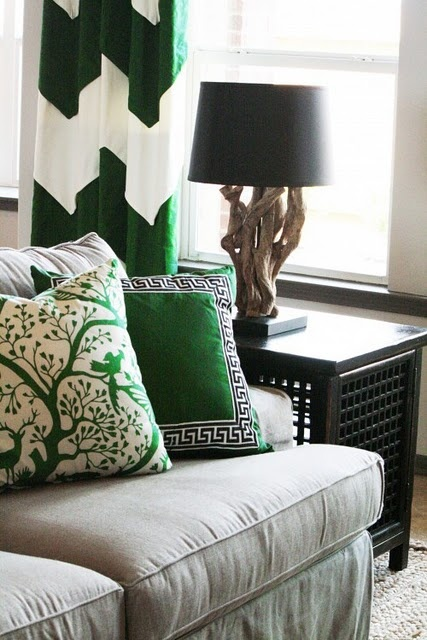 Emerald green accents really dress up a bland khaki living room.