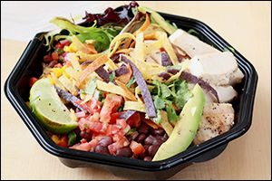 Chili's Margarita Chicken Fresh Mex Bowl 2 tbsp. lime juice  1/8 tsp. garlic  1/8 tsp. salt & pepper  2 tbsp. finely chopped cilantro  3-oz. chicken breast cutlet 1/2 cup cooked brown rice  1/2 cup chopped tomatoes  3 tbsp. chopped red onion  2 tbsp. chopped jalapeño slices   1/2 cup mixed salad greens  3 tbsp. canned black beans 3 tbsp. sweet corn kernels 1/2 oz. sliced avocado  3 baked tortilla chips, lightly crushed  Optional garnishes: chopped cilantro, lime wedges